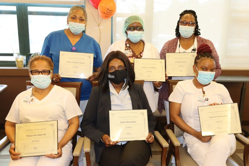 Group of employees with certificates